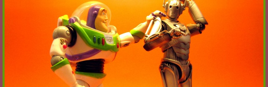 A toy Buzz Lightyear taps a toy Cyberman on the shoulder