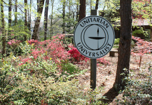 Unitarian Universalist Sign with Spring Blooms in Background