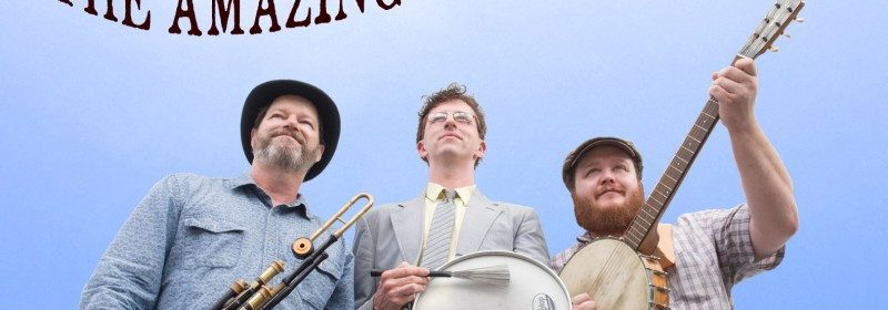 Photo of The Amazing Spud Brothers with instruments against blue sky