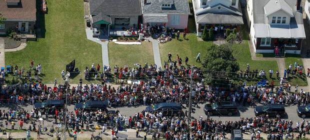 aerial view of Mohammad Ali's funeral procession going past his childhood home