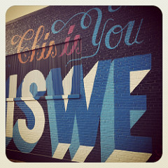 "Mural in Memphis. ""This is You,"" in curly script. ""This is WE,"" below, much bolder and larger."